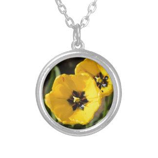 Couple of bright yellow tulip flowers jewelry