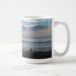 Couple on Beach Gazing into Sunset and Ocean Coffee Mug