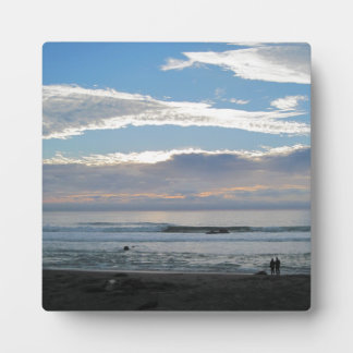 Couple on Beach Gazing into Sunset and Ocean Display Plaque