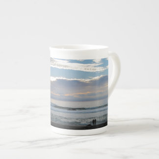 Couple on Beach Gazing into Sunset and Ocean Tea Cup