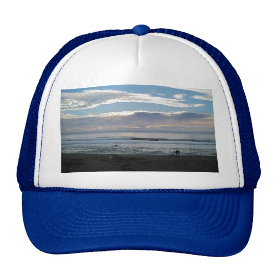 Couple on Beach Gazing into Sunset and Ocean Trucker Hat