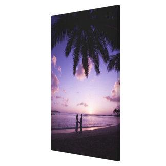 Couple on beach, Windjammer Landing, St. Lucia Canvas Print