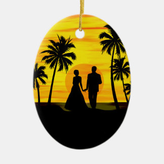 Couple overlooking a sunset on the beach ceramic ornament