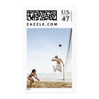 Couple Playing Beach Volleyball at Six Senses Postage