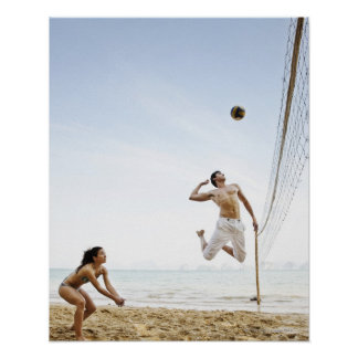 Couple Playing Beach Volleyball at Six Senses Poster
