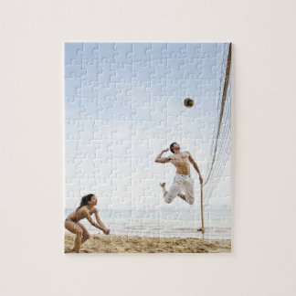 Couple Playing Beach Volleyball at Six Senses Jigsaw Puzzles
