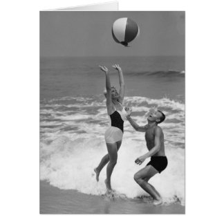Couple Playing with a Beachball Greeting Card