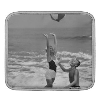 Couple Playing with a Beachball iPad Sleeve