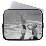Couple Playing with a Beachball Laptop Sleeves