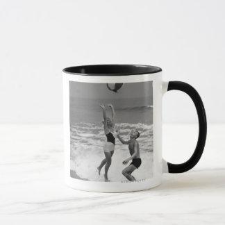 Couple Playing with a Beachball Mug