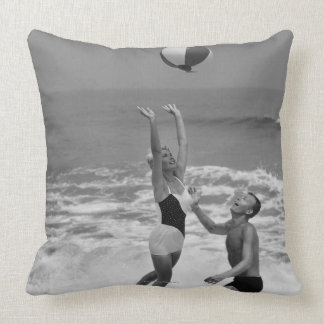 Couple Playing with a Beachball Pillow