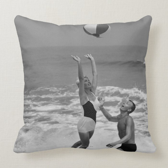Couple Playing with a Beachball Throw Pillow