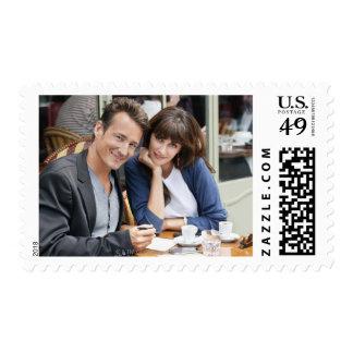 Couple sitting in a restaurant, Paris, Postage
