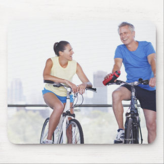Couple sitting on bicycles mouse pad