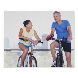 Couple sitting on bicycles poster
