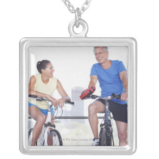 Couple sitting on bicycles silver plated necklace