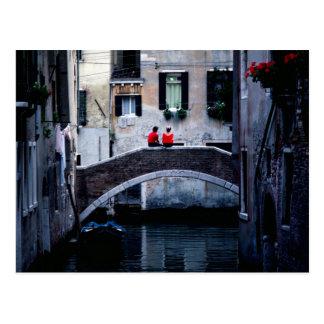 Couple sitting on bridge spanning canal Venice I Postcard