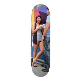 Couple Talking Skateboard