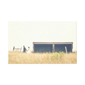Couple walking in a field in the country photo canvas print