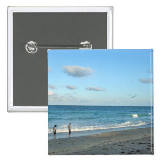 Couple walking on florida beach w seagull pinback buttons