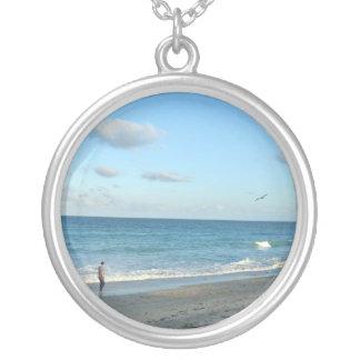 Couple walking on florida beach w seagull round pendant necklace