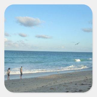 Couple walking on florida beach w seagull sticker