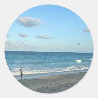 Couple walking on florida beach w seagull round stickers