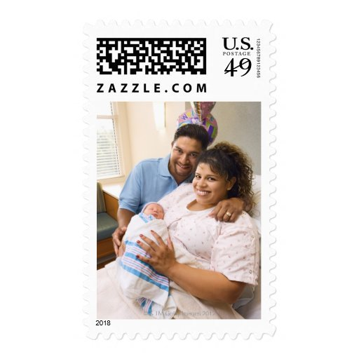 Couple with newborn postage stamps