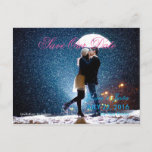 Couple with umbrella kissing at snow/Save The Date Announcement Postcard