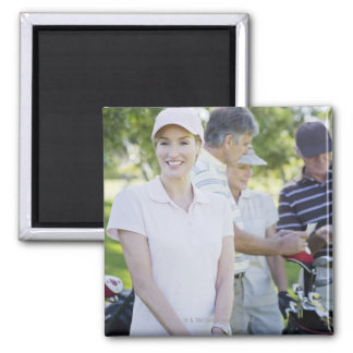 Couples preparing to play golf 2 inch square magnet