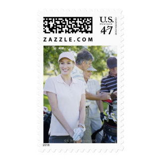 Couples preparing to play golf postage stamp