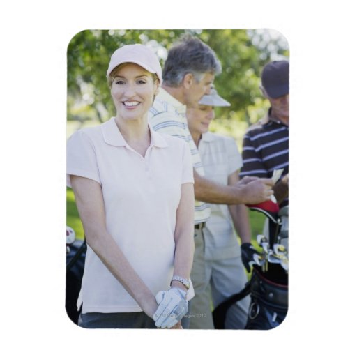Couples preparing to play golf rectangle magnet