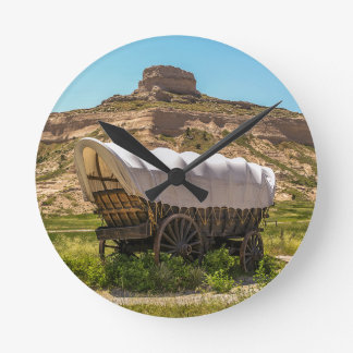 Covered Wagon at Scotts Bluff National Monument Round Clock