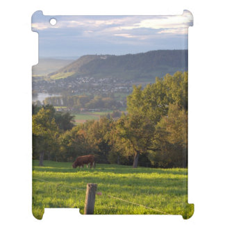 Cow grazes in stunning landscape iPad covers