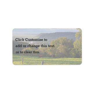 Cow grazes in stunning landscape label