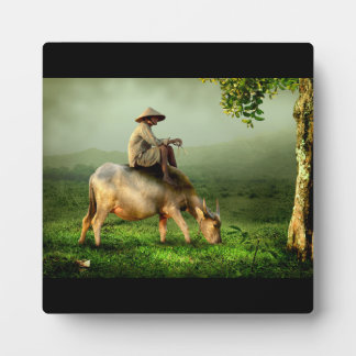 Cow Grazing with Farmer in a Scenic Pasture Plaque