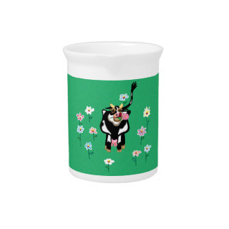 Cow in a field of grass and flowers drink pitchers