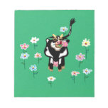 Cow in green pastures with flowers scratch pad