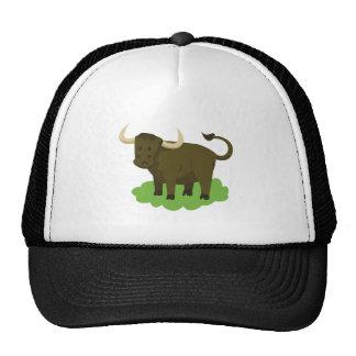 cow in the grass trucker hat