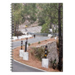 Cow on a mountain road spiral note book