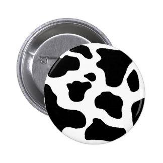 Cow print black and white blotchy pattern button