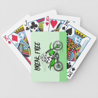 Cow riding a green motor cross bike bicycle playing cards