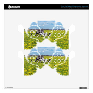 Cow with calves grazing in meadow with dandelions PS3 controller decal