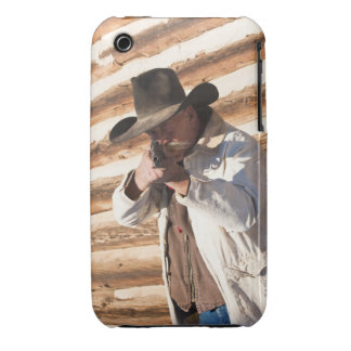 Cowboy aiming his gun, standing by an old log iPhone 3 cover