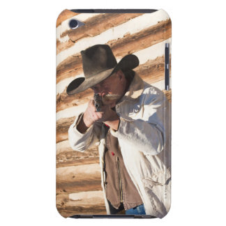 Cowboy aiming his gun, standing by an old log iPod touch cases