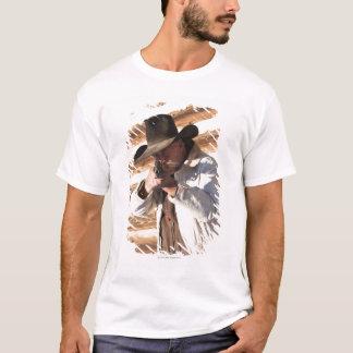Cowboy aiming his gun, standing by an old log T-Shirt