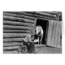 Cowboy and a horse looking at a letter cards