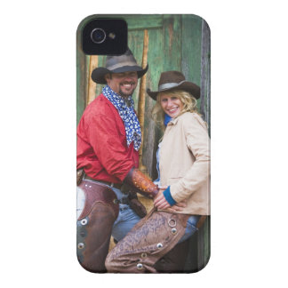 Cowboy and cowgirl holding hands in front of an Case-Mate iPhone 4 case