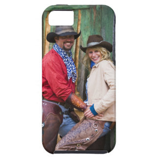 Cowboy and cowgirl holding hands in front of an iPhone SE/5/5s case