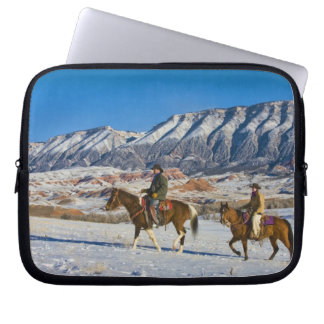 Cowboy and Cowgirl riding Horse through the Snow Computer Sleeve